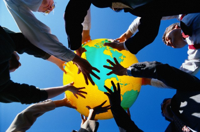 Businesspeople Holding Up a Globe --- Image by © 2/Ryan McVay/Ocean/Corbis